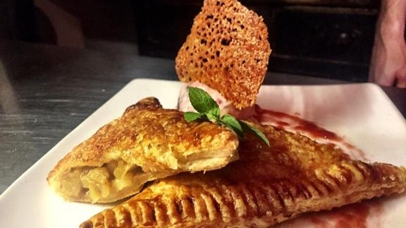Apple-pear pie, brown butter-plum swirled ice cream, cheddar crisp. at Beast Restaurant