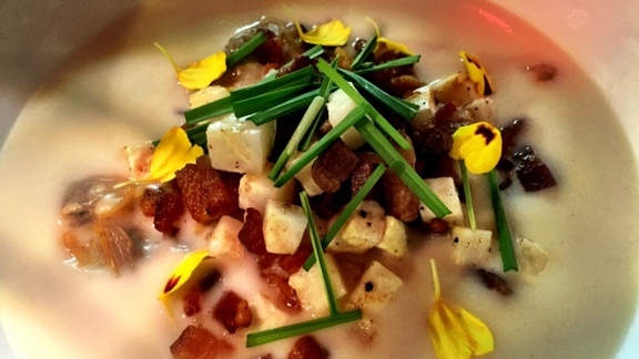 Manila clams, celery root, bacon lardon, crispy rice, & field garlic. at Beast Restaurant