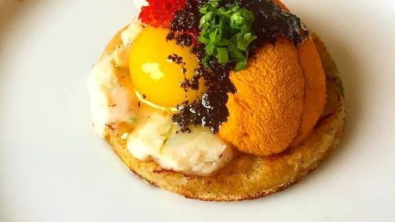 Potato flatbread, uni, whipped lardo, yolk, tobiko, black garlic, sorrel at Rebel Restaurant