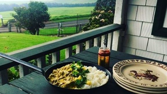 Lamb curry with chili sauce, rice and mango at Merrimans Restaurant Waimea Big Island