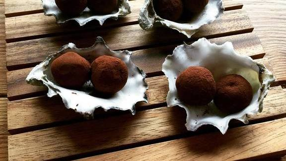 Mole-kissed black pearl truffles at Olympia Oyster Bar