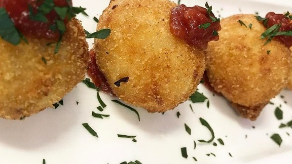 Chef Beverly Gannon reviews Prosciutto Croquettes; asiago parmesan, local tomato marmalade at Gannon's Restaurant