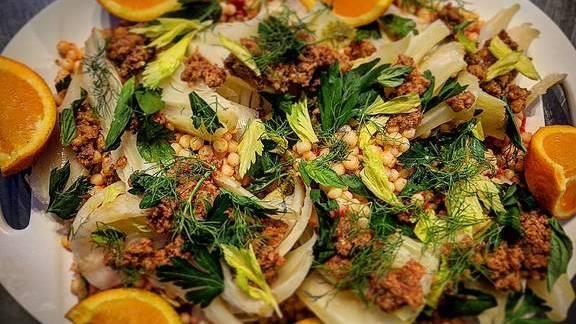 Israeli couscous, castelvetrano olive, roast tomatoes, fennel, walnut purée at Le Kitchen