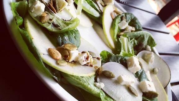 Chef Duncan Biddulph reviews Wolf river apple salad, black radish, goat feta and toasted pumpkin seeds at Fifty First Kitchen & Bar
