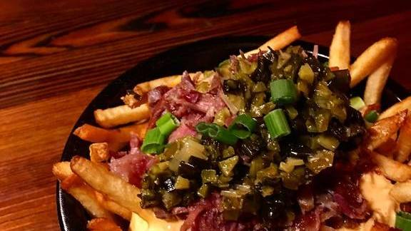 Fries with cheese, ham, scallion relish, and cornichons at Old Kan Beer & Co.