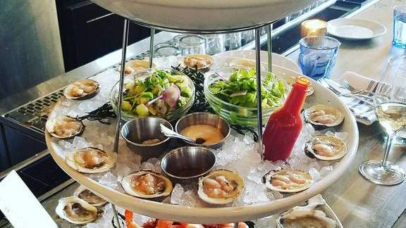 Seafood tower with oysters and ceviche at The Ordinary