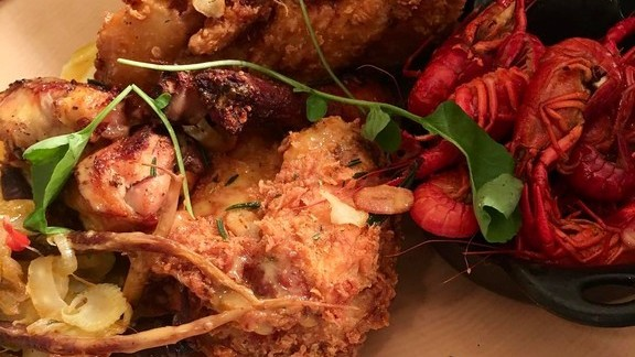 Fried chicken and crawfish at Emeril's New Orleans