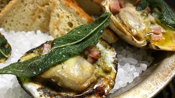 Citrus caper butter, house-cured ham and crispy sage at Lucy's Fried Chicken