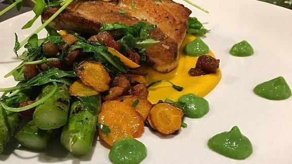 Chef Shayne Nunes reviews Pan roasted mahi mahi, crispy pancetta, grilled asparagus, arugula, English pea and herb puree, carrot-coconut sauce at Foundry On Elm