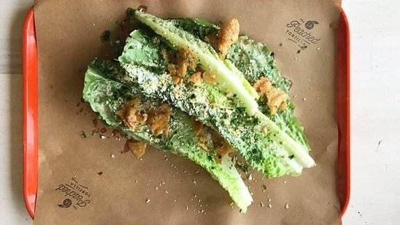 Chef Eric Silverstein reviews Asian Caesar salad at The Peached Tortilla