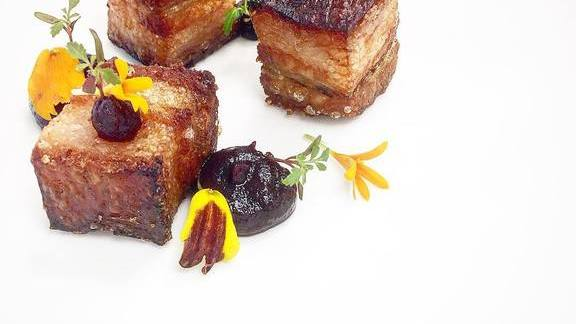 Pork belly, red cabbage, and marigold  at Langdon Hall