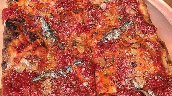 Pizza with tomato and anchovy at Corner Slice