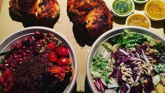 Rotisserie chicken, vegetables and greens at Flock