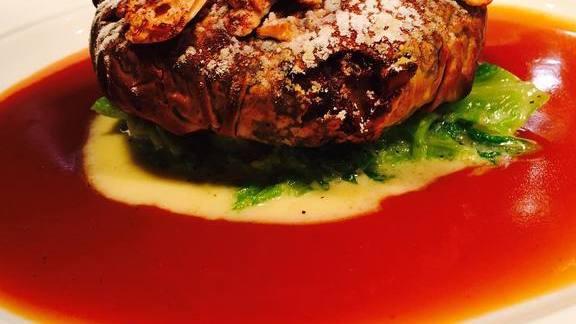 Lamb pastilla with cabbage, almond, cinnamon, and powdered sugar at Central Michel Richard
