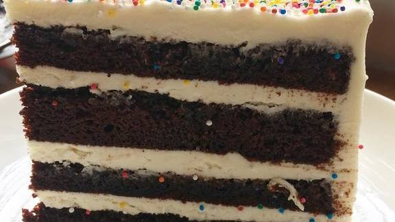 Devils food chocolate cake, fluffy vanilla buttercream and rainbow sprinkles at Myers + Chang