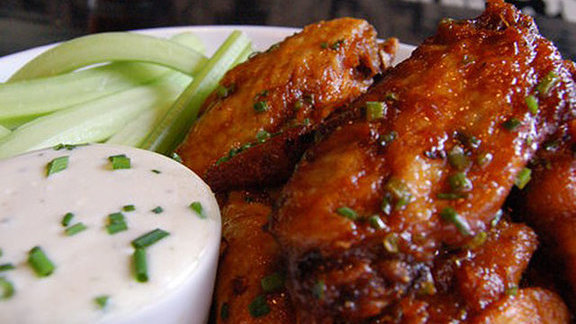 Chef Monica Glass reviews Duck confit chicken wings at