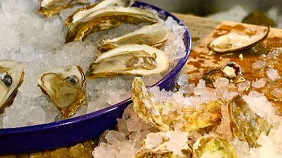 Chef James Holmes reviews Gulf oysters on the half shell at