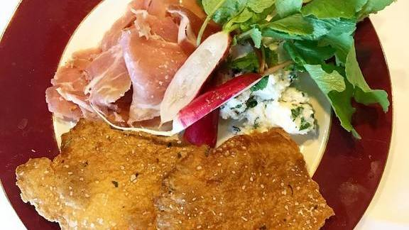 Ham with radishes, goat cheese, and crackers at Cafe Margot