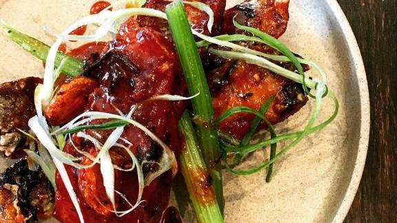 Pork riblets, orange gastrique, Aleppo pepper, pickled Chinese celery and scallions at Here's Looking at You