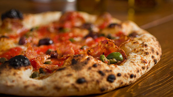 Chef Brian Landry reviews Calabrese pizza at Domenica