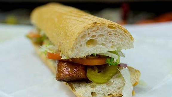 Grilled hot sausage pork link po' boy at Parkway Bakery & Tavern