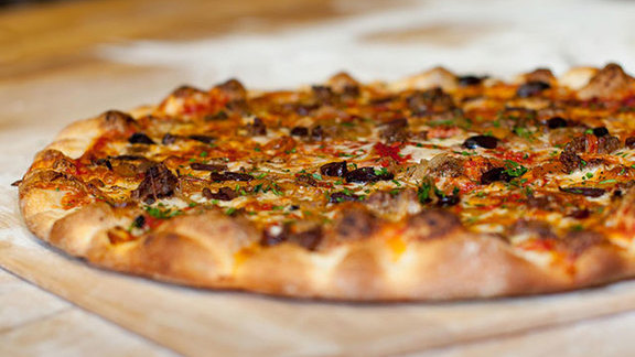 Garlic sautéed mushroom & pancetta pizza at Pizza Delicious