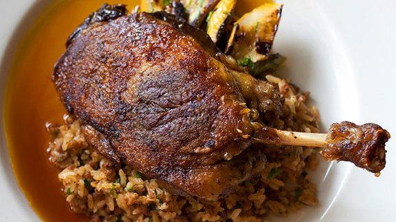 Chef Ryan Prewitt reviews Muscovy duck leg confit at Herbsaint
