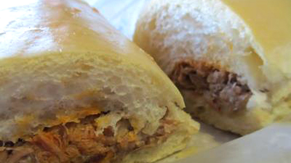 Chef Alberto Cabrera reviews Pork sandwich at