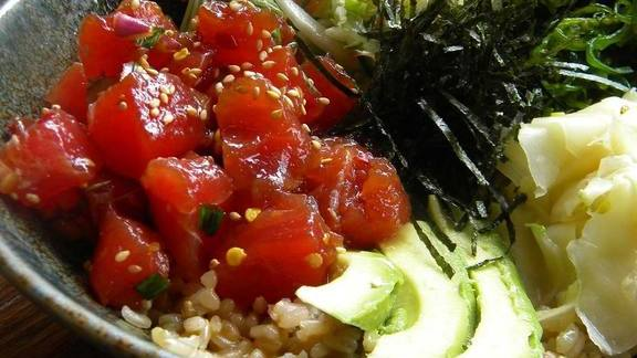 Poke bowl with ahi tuna, brown rice, avocado, seaweed, ginger, and cabbage at Pacific Catch