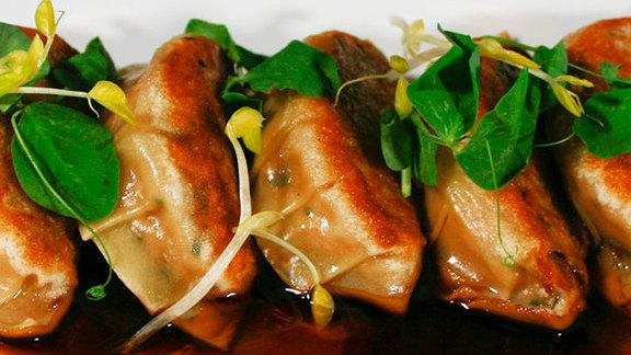 Chef Adrianne Calvo reviews Pork belly & scallion dumplings at Pubbelly