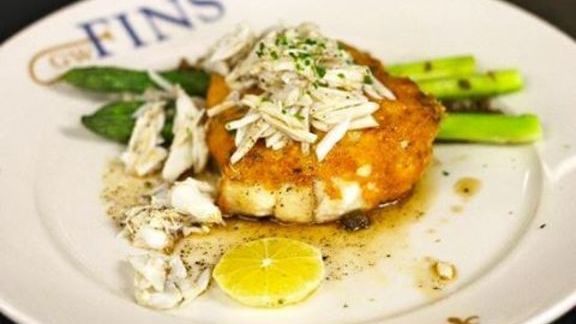 Chef Tenney Flynn reviews Parmesan crusted flounder with lemon and asparagus at GW Fins