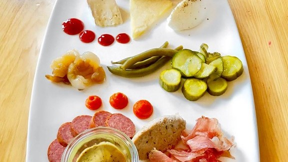 Cheeses, pickles, bread, and cured meats at Mercantile Dining & Provision