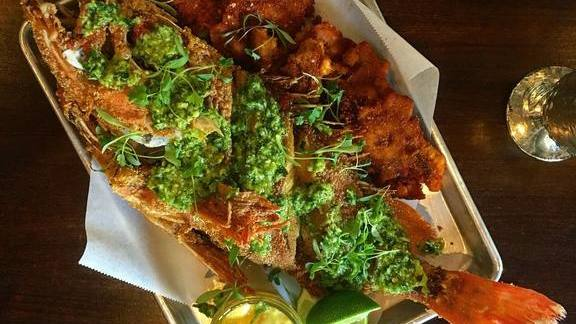 Chef Sammy Monsour reviews Fried whole black gill rock fish with Cuban chimi, cajun tostones, and lime and coconut remoulade at Preux & Proper