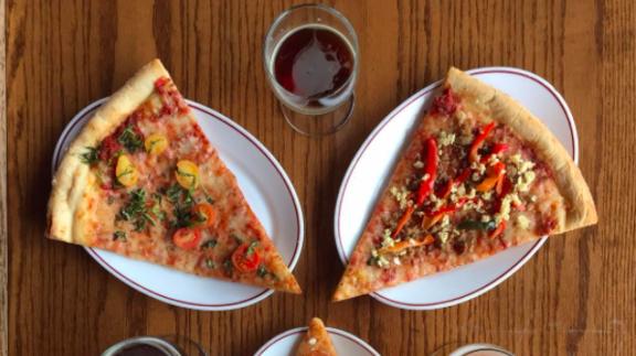 Slice of pizza at Pi Bar