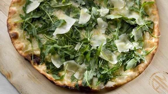 White pizza w/ arugula at Piccolo Sogno