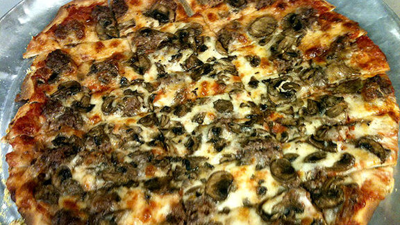 Chef Kent Rathbun reviews Sausage & mushroom pizza at