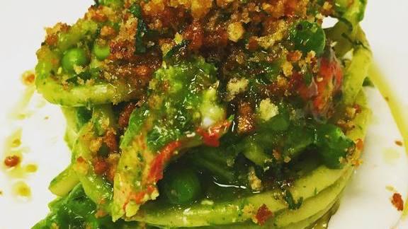 Lobster spaghetti, spring garlic pesto, English peas, stracciatella di bufala, gremolata at STK Rooftop