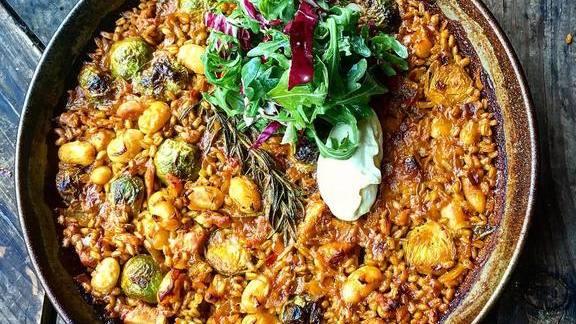 Paella de farro y carne: farro perlata + rabbit + gigante beans + Brussels sprouts + allioli at Duende