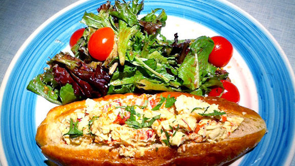 Curry lobster roll at Miss Lily's & Melvin's Juice Box