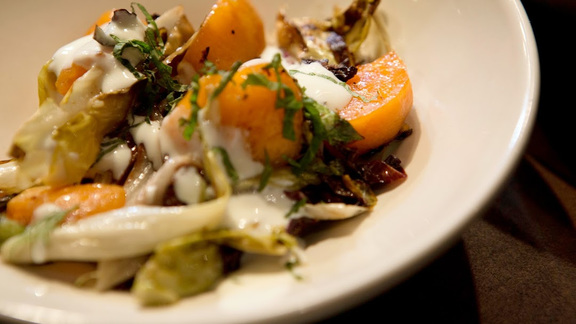 Fuyu persimmon & chicories with pistachios, mint & yogurt at Del Popolo Truck