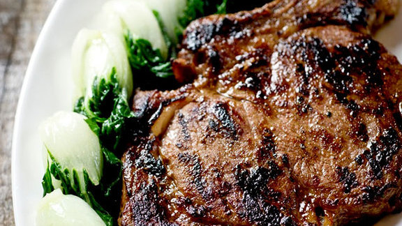 Grilled marinated Creekstone rib steak, bok choy at RedFarm