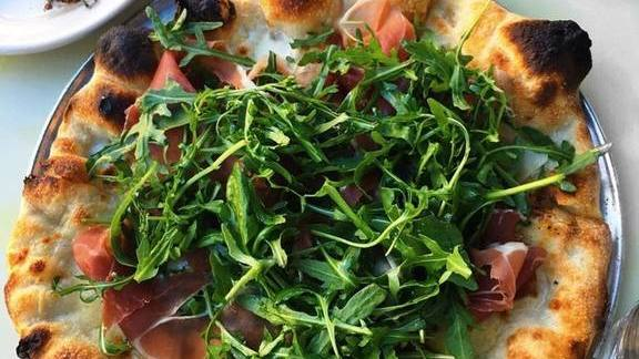 Prosciutto and arugula pizza pie at Pizzeria Delfina