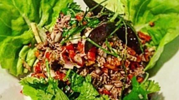 Beef tenderloin, shallots, curry paste, garlic, ginger, onion, cilantro, bell pepper, shrimp, and lettuce at Malai Thai Vietnamese Kitchen & Bar