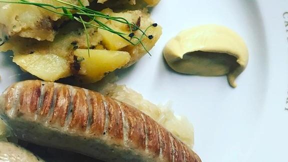 Bratwurst, sauerkraut and mustard at Café Sabarsky