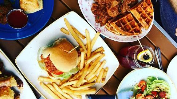 Burger and fries, chicken and waffles, biscuits and gravy at Yardbird Southern Table & Bar