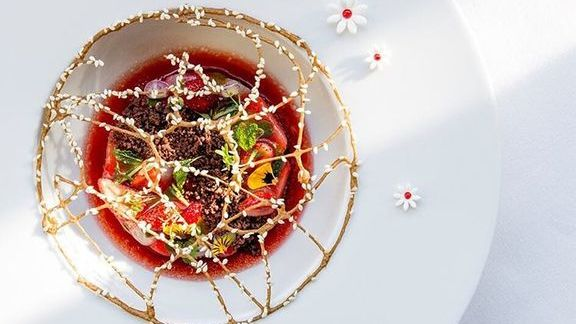 Chef Alain Ducasse reviews Pistachio and Strawberry field, floral garnish at Alain Ducasse at The Dorchester