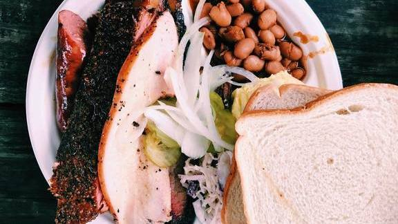 Chef Timothy Hollingsworth reviews Barbecue plate with beans, pickles, and white bread at Franklin Barbecue