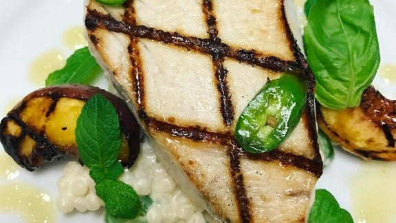 Grilled swordfish, peaches, Israeli couscous and Serrano peppers  at La Provence