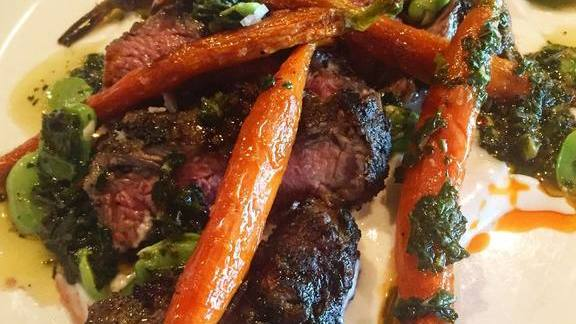 Roasted lamb leg, peas and carrots at Osteria