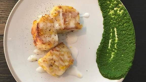 Chef Nick Erven reviews Steamed corn cake with green harissa and coconut at Erven